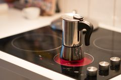 Coffee pot on electric stove. Domestic kitchen stock image