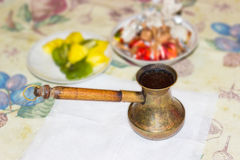 Coffee pot with freshly brewed Turkish coffee on a table Royalty Free Stock Image