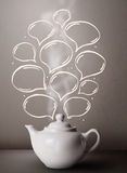 Coffee pot with hand drawn speech bubbles Royalty Free Stock Photos