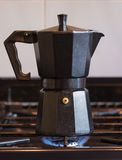 Coffee pot on hob Royalty Free Stock Image