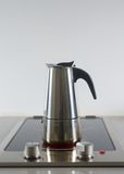 Coffee pot on a hot stove Stock Photo