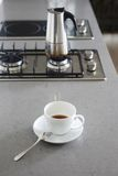 Coffee pot on kitchen gas stove Stock Images
