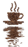 Coffee pot with reflecton. Coffee cup and saucer laid out with coffee beans on white background with reflecton stock photo