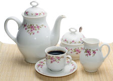 Coffee-pot with several objects. On the mat Royalty Free Stock Image