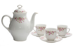 Coffee-pot and three cups royalty free stock image