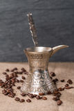Coffee pot turk and  coffee beans Stock Image