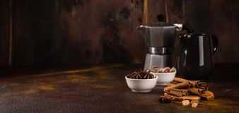 Coffee Pot With Spices On Brown Background. Royalty Free Stock Images