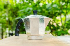 Coffee pot on wooden board Royalty Free Stock Image