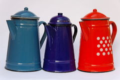 Coffee pots. Three coffee pots of different colors stock photo