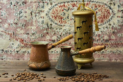 Coffee pots on dark rustic background. Old coffee pots on dark rustic background Stock Photo