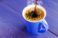 Coffee pour blue Royalty Free Stock Photo