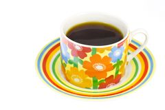 Coffee poured into a coffee cup with a flower pattern Royalty Free Stock Images
