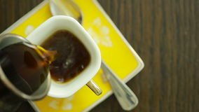 Coffee is poured into the mug. view from above. hot drink stock footage