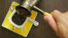 Coffee is poured into the mug. view from above. hot drink stock video footage