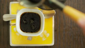 Coffee is poured into the mug. view from above. hot drink stock video