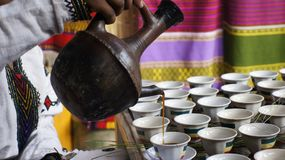 Coffee pouring Ethiopian Tradition. Hot coffee being poured in the Ethiopian coffee ceremony Royalty Free Stock Photo