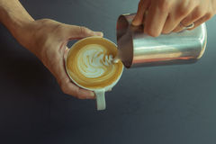 Coffee. Pouring milk make latte art coffee Royalty Free Stock Images