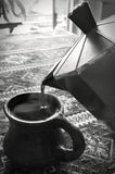 Coffee Pouring From A Pot royalty free stock photos