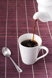 Coffee pouring in to mug. Fresh mornig coffee pouring in to mug Royalty Free Stock Photos