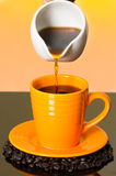 Coffee pouring from white glass kettle into Stock Photo