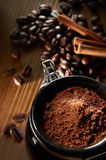 Coffee Powder. With coffee bean and cinnamon stick in background Stock Photos