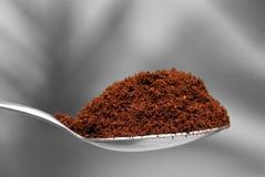 Coffee powder. Teaspoonful of fresh coffee powder Royalty Free Stock Photos