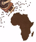 Coffee powder in the shape of Africa and a coffee mill.(series) Royalty Free Stock Photography