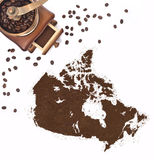 Coffee powder in the shape of Canada and a coffee mill.(series) Royalty Free Stock Photo