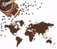 Coffee powder in the shape of the world and a coffee mill.(serie Royalty Free Stock Photo