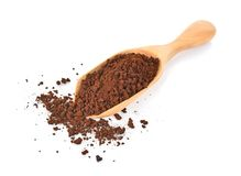 Coffee powder in spoon on white background royalty free stock photography