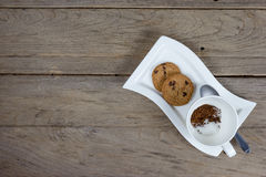 Coffee powder and sugar in cup with cookies Royalty Free Stock Photos