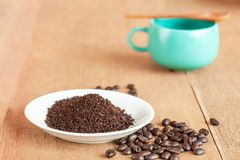 Coffee powder in white dish on wood. Table royalty free stock photo