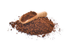 Coffee powder in wooden scoop isolated on white background Stock Photography