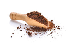 Coffee powder in wooden scoop isolated on white Royalty Free Stock Photography