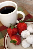 Coffee with powdered donuts and strawberries Stock Photos