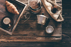 Coffee preparation on old wooden table Royalty Free Stock Images