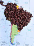 Coffee producers in South America. South America map, coffee producer countries paved with coffee beans stock photos