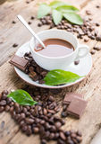 Coffee products,coffee brake. Coffee product with steam and a few green levaes Royalty Free Stock Images