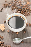 Coffee products,coffee brake. Coffee with steam and coffee been around Royalty Free Stock Photo