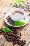 Coffee products,coffee brake. Coffee steam and few green leaves and wooden floor Stock Image