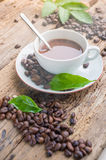 Coffee products,coffee brake. Coffee with steam and a few coffee seeds Royalty Free Stock Photography