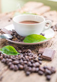 Coffee products,coffee brake. Coffee with steam and a few coffee seeds Stock Images