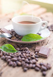 Coffee products,coffee brake. Coffee with steam and a few coffee seeds Royalty Free Stock Images