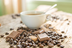 Coffee products,coffee brake. Coffee with steam and a few coffee seeds Stock Image
