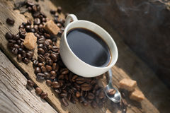 Coffee products,coffee brake. Coffee steam and coffee product on a wooden floor and sugar and coffee beens Royalty Free Stock Photography