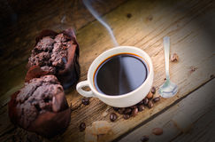 Coffee products,coffee brake. Coffee with steam and two sweet cakes Royalty Free Stock Photo