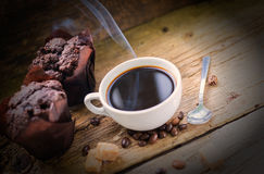 Coffee products,coffee brake. Coffee with steam and two sweet cakes Royalty Free Stock Photos