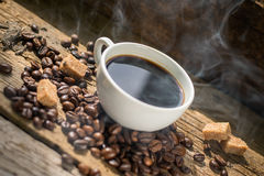 Coffee products,coffee brake. Coffee with steam and two sweet cakes Royalty Free Stock Photography