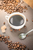 Coffee products,coffee brake. Coffee with steam and two sweet cakes Stock Images