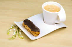 Coffee with profiterole Stock Photo
